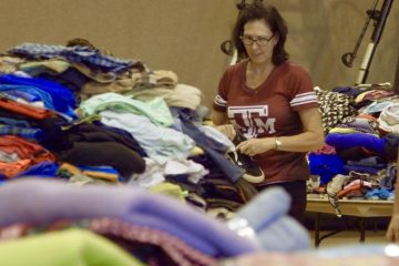 Hurricane Harvey victim finds shoes and clothes.